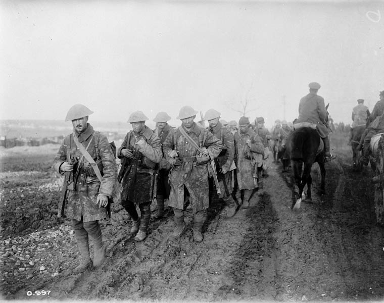 Soldiers marching through the mud.