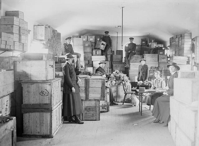 View of a storage room filled with crates and boxes.
