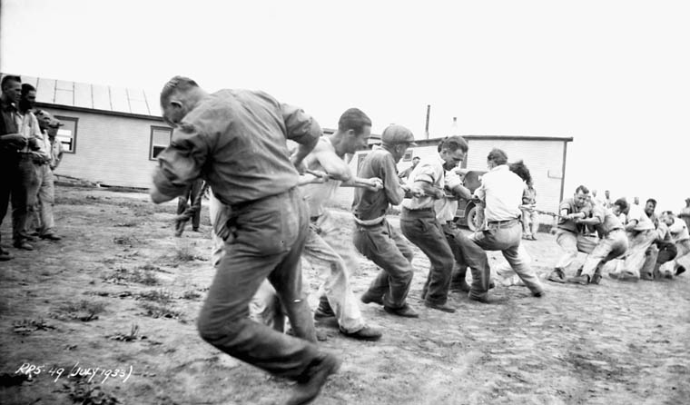 Photograph of Army Unemployment Relief Project workers having a tug-of-war in Megantic, Quebec, July 1933