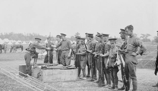 Soldiers handling rifles.