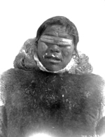 Netselingment man wearing native snow goggles - photo at village on ice South of Rae Strait, [N.W.T.].
