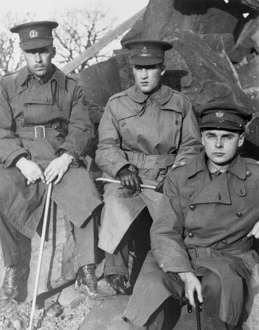 Three soldiers in trenchcoats.