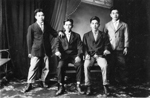 Photograph of four unidentified young Okinawan men in Western dress