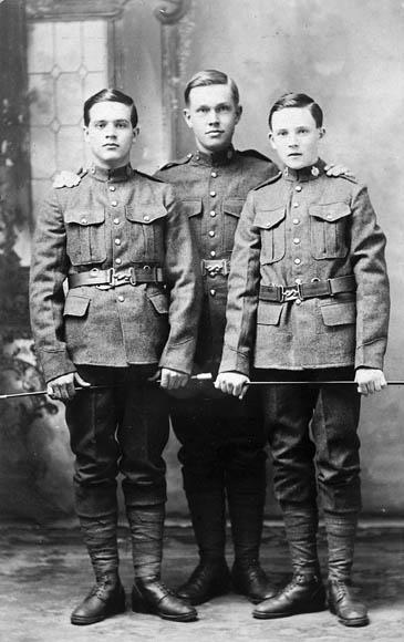 Three boys in uniform.