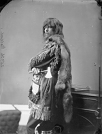 Studio photograph of Dr. Malloch dressed in a fringed tunic trimmed with fur, Ottawa, March 1876