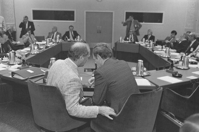 Photograph of Prime Minister Pierre Elliott Trudeau consulting with Minister of Justice Jean Chrétien during Constitutional Conference, Ottawa, 1981