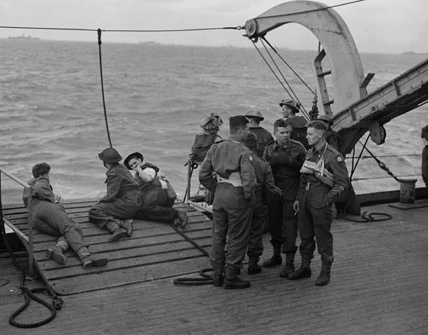 Unidentified soldiers preparing to disembark from H.M.C.S. PRINCE DAVID off the Normandy beachhead, France, 6 June 1944.