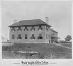 Black and white photograph of a large, two-storey brick building