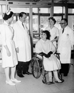 Photograph of doctors and nurses with patient admitted to the Rehabilitation Institute of Montreal