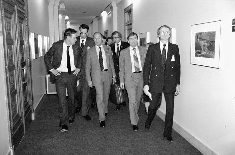 Photograph of Prime Minister Pierre Elliott Trudeau and federal delegates at the Federal-Provincial Conference of First Ministers on the Constitution, Ottawa. 1981