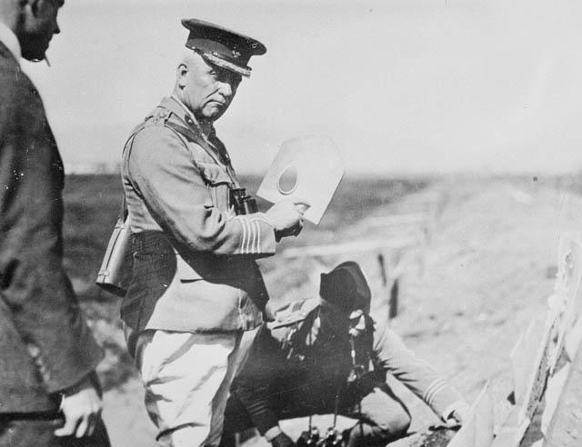 Sir Sam Hughes holding a MacAdam shovel.