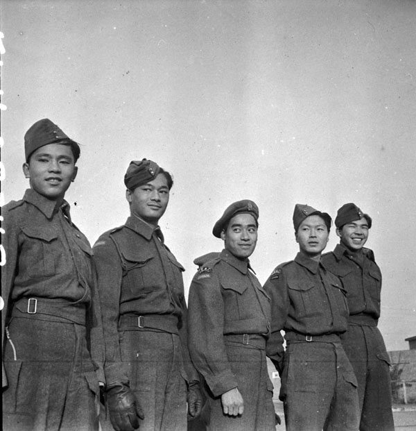 Photograph of five men in army uniform, smiling for camera