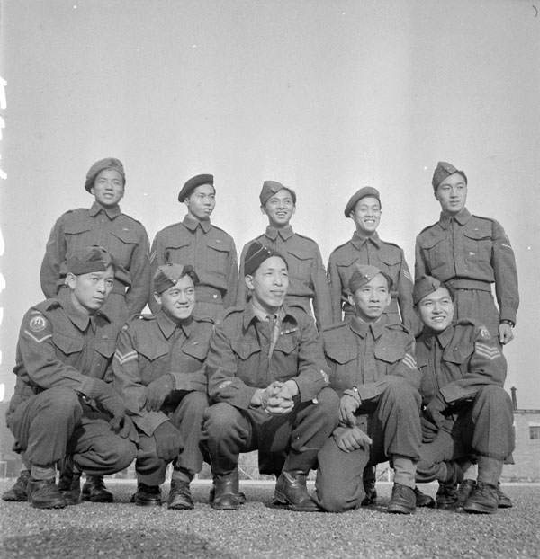 Photograph of two rows of men from Vancouver in army uniform, smiling for camera