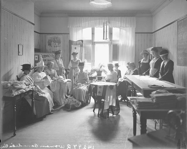 Photo: group of women in a sewing room.