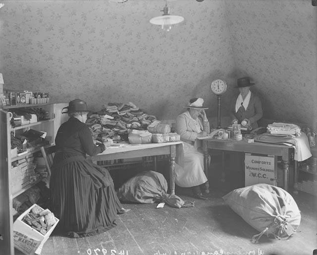 Women in a supply room filling orders.