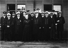 Photograph of a group of immigration officers in uniform, ca. 1908
