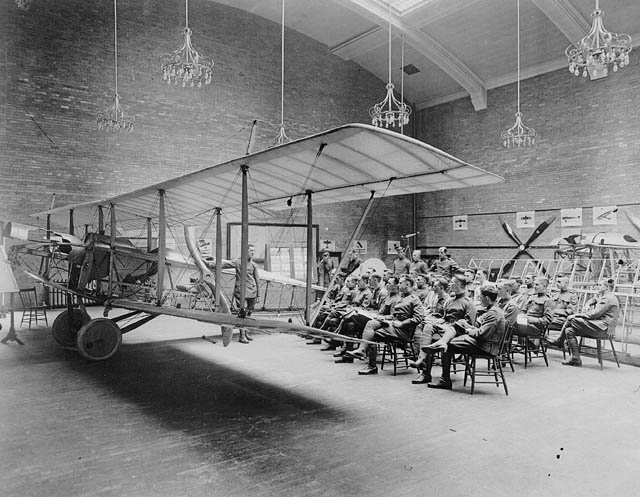 Students in a room with an airplane.