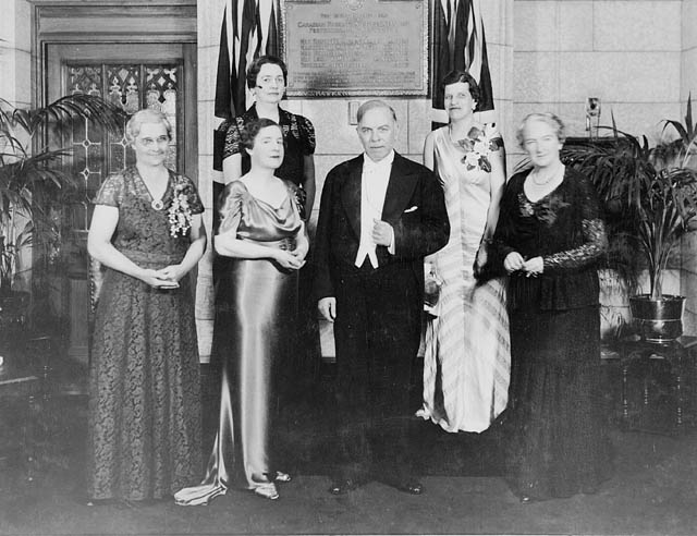 Photograph of Prime Minister William Lyon Mackenzie King with guests of honour at the unveiling of a plaque commemorating the five Alberta women whose efforts resulted in the Persons Case, which established the rights of women to hold public office in Canada, June 11, 1938