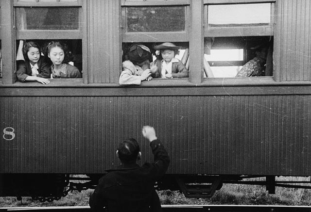 Photograph of Japanese-Canadian women being relocated by train to internment camps in the interior of British Columbia, 1942