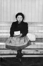 Photograph of a young Galician immigrant girl holding an envelope labelled RED STAR LINE, 1905