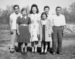 Photograph of the Takatsu family who settled on a farm, La Rochelle, Manitoba