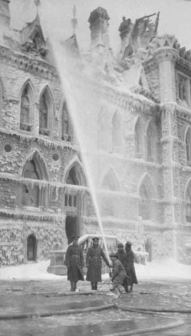 Firemen spraying water on the Centre Block