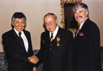Photograph of Dr. Gustave Gingras (centre) receiving the Décoration du Ouissan Alaouite, in the company of Maati Jorio and Jacques Nolet