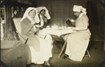 Nursing sisters Alice Thompson, Viola Beers and Alice Isaacson having tea, No. 2 Canadian General Hospital, Le Tréport, France. 1917