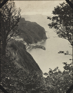 Photograph of the coastline and sea at Clovelly, England, unknown date