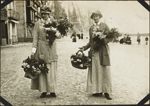 Two unidentified nursing sisters carrying flowers, No. 2 Canadian General Hospital, Le Tréport, France
