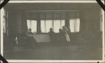 Photograph of three nursing sisters and two officers at the table in the tea room, No. 6 Canadian General Hospital, Joinville-le-Pont, France, 1918