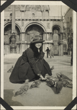 Photograph of nursing sister Marie-Antoinette Sirois feeding pigeons in St. Mark's Square, Venice, Italy, March 24-26, 1919