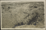 Photograph of men in a large shell-hole, Verdun, France, August 1916